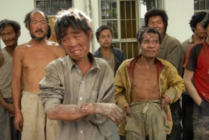 Workers stand at a police station after they were rescued from a brickworks in Hongdong County in Linfen